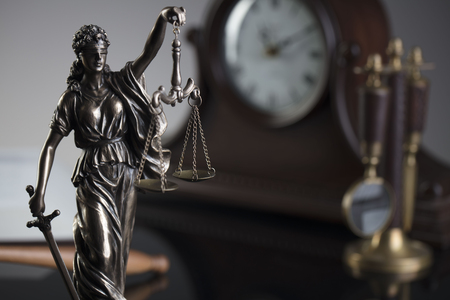Law concept. Themis - statue of justice. Gray background. Stock Photo