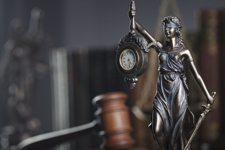 Law concept. Gavel of  the judge, statue of the justice and legal books. Gray background.