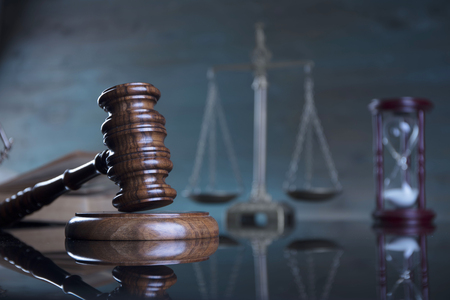 Law concept. Gavel of  the judge, scale of the justice. Gray background.