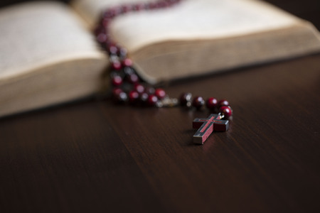 Religion concept background. Christianity. Holy Bible and rosary.