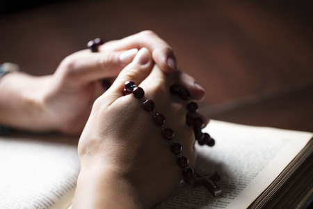 Religion concept background. Christianity. Holy Bible and rosary. Prayer symbols. Stock Photo
