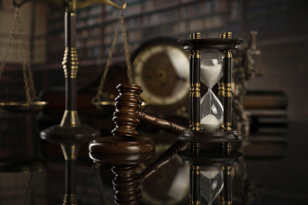 Law concept. Gavel of  the judge, scale and legal books. Courtroom library.