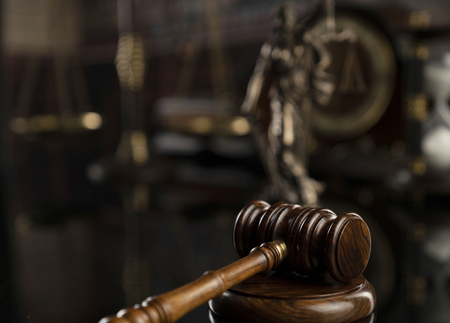 Law concept. Gavel of  the judge, statue of the justice and legal books. Courtroom library. Stock Photo