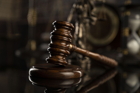 Law concept. Gavel of  the judge and legal books. Courtroom library. Stock Photo