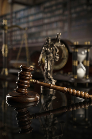 Law concept. Gavel of  the judge, statue of the justice, scale and legal books. Courtroom library. Stock Photo