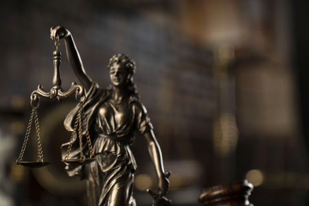 Law concept. Statue of the justice and legal books. Courtroom library. Stock Photo