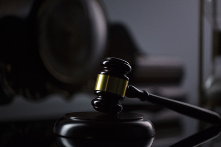 The law concept background.  Gavel of  the judge on the gray background. Stock Photo