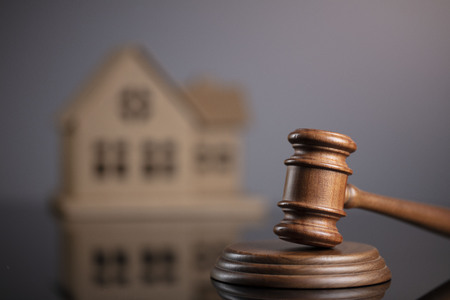 Constuction law concept. Gavel and house model.
