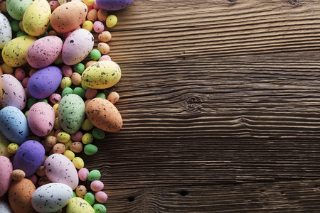 Easter background. Easter eggs. Rustic wooden table. Top view.