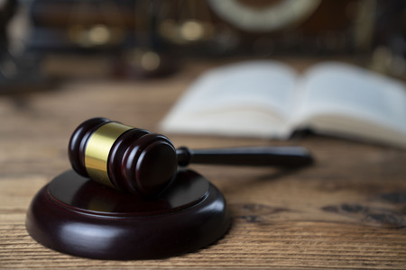 Law concept. Judges gavel on rustic wooden table.