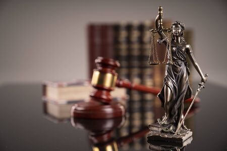 Statue of justice - Themis, legal codes and gavel of the judge.