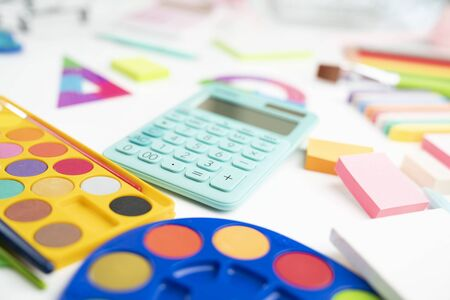 School supplies. Set of colorful school accessories isolated on the white table.