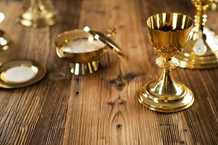 Catholic concept background. The Cross, monstrance and golden chalice on the altar. Stok Fotoğraf