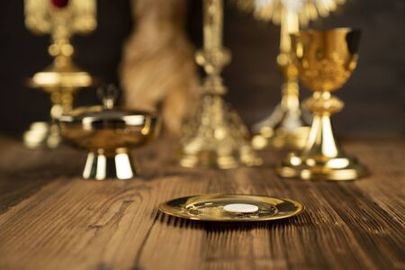 Catholic concept background. The Cross, monstrance,  Holy Bible and golden chalice on the altar. Stok Fotoğraf
