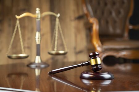 Law concept. Gavel of  the judge and the scale on the wooden background. Stok Fotoğraf