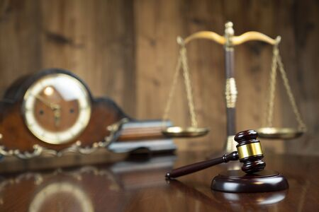 Law concept. Gavel of  the judge, the clock and the scale on the wooden background. Stok Fotoğraf