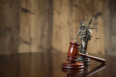 Law concept. Gavel of  the judge and Themis statue on the wooden background. Stok Fotoğraf