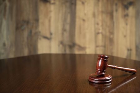 Law concept. Gavel of  the judge on the wooden background.