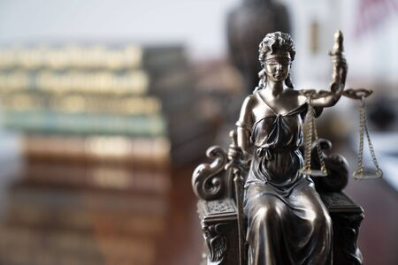 Law and justice theme. Themis statue – the symbol of blind justice. Stock Photo