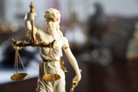 Law and justice theme. Themis statue – the symbol of blind justice. 写真素材
