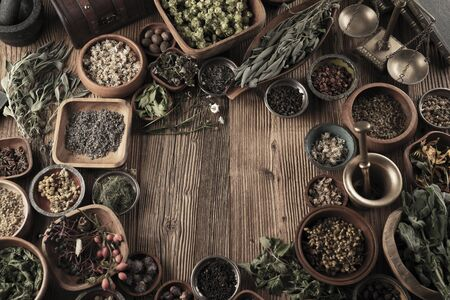 Spices theme. Collection of spices in bowls on wooden rustic table. Place for text or typography. Stockfoto - 132103715