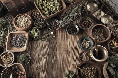Spices theme. Collection of spices in bowls on wooden rustic table. Place for text or typography. Stockfoto - 132103829