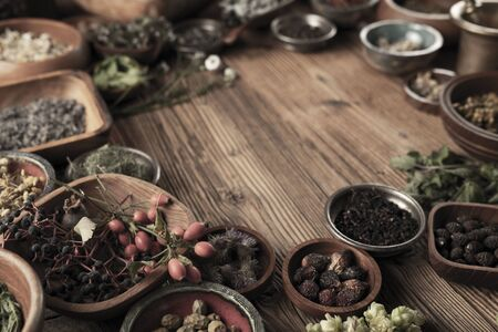 Spices theme. Collection of spices in bowls on wooden rustic table. Place for text or typography. Stockfoto - 132103900