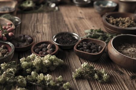 Spices theme. Collection of spices in bowls on wooden rustic table. Place for text or typography. Stockfoto - 132103922