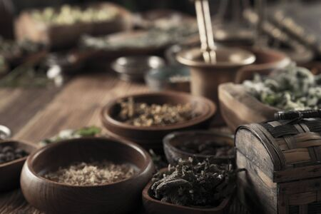 Spices theme. Collection of spices in bowls on wooden rustic table. Place for text or typography. Stockfoto - 132103841
