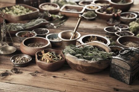 Spices theme. Collection of spices in bowls on wooden rustic table. Place for text or typography. Stockfoto - 132103886
