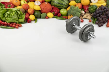 Fitness concept – healthy nutrition and equipment for fitness exercises on the white background. Reklamní fotografie