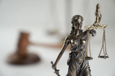 Law symbol composition. Gavel of the judge, Themis statue and scale of justice on off-white background.