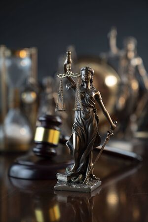 Law symbol composition and background. Judges gavel, Themis statue.