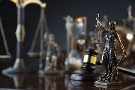 Law symbol composition and background. Judges gavel, Themis statue and scale. Stockfoto
