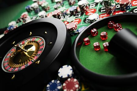 Casino concept. Gambling games.  Roulette, dice and chips on the roulette table with red and black numbers.