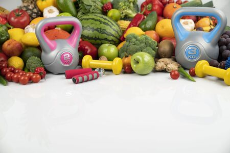 Fitness concept.  Healthy nutrition and fitness equipment on the white background.