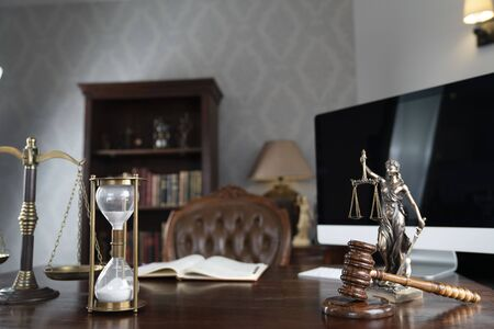 Lawyers office concept. Law symbols composition: gavel, scale and Themis statue. Stock Photo