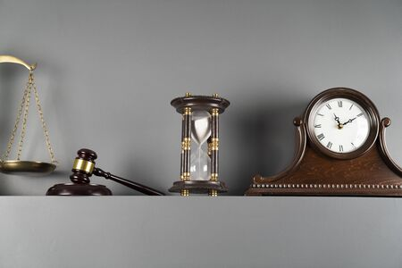 Lawyers office concept. Law symbols composition – gavel and scale on off-white background.