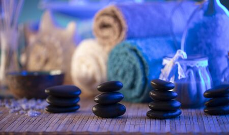 Spa and wellness concept. Bottles with cosmetics, bath salts and care products on wooden paneling. Stock Photo