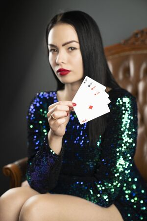 Casino. Portrait of pretty young female casino player. Stock Photo