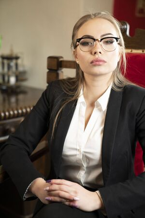 Female advocate in lawyer's office