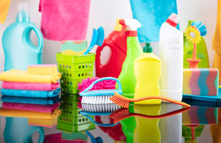 House and office cleaning theme. Colorful cleaning kit on glass table. 写真素材