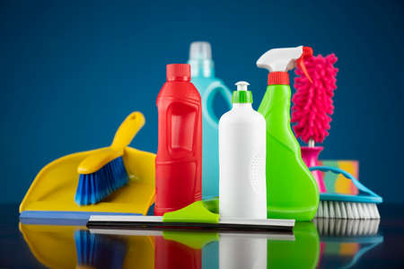 House and office cleaning theme. Colorful cleaning kit on blue background. Archivio Fotografico