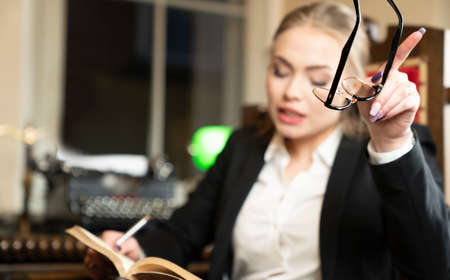 Young female lawyer during work in chamber.