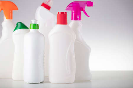 House and office cleaning theme. Set of white bottles with clining liquids on the white  background.
