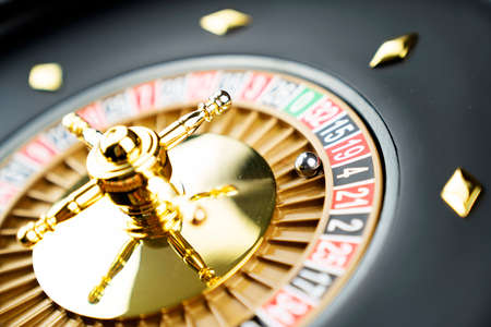 Casino theme.  Roulette wheel on green table.