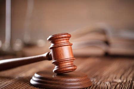 Law theme. Lawyers office. Gavel on the rustic brown desk. 版權商用圖片