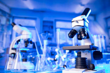 pandemic theme. Science research concerning fast tests and anti- vaccine. Microscope, beakers and test tubes in the scientific laboratory.