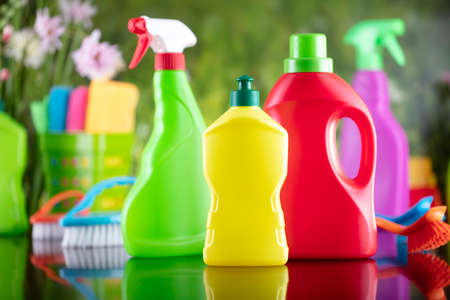 Spring house and office cleaning. Cleaning kit and sources on the glass table. Bokeh  background. 版權商用圖片
