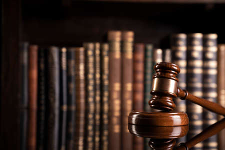 Law theme. Judge chamber. Judge's gavel and collection of legal books in the bookshelf. 版權商用圖片